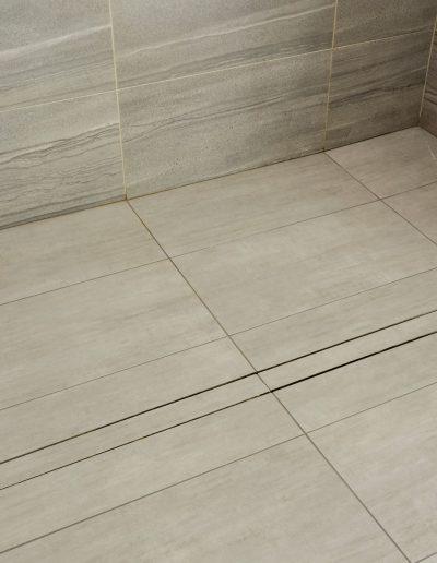 Basement Bathroom After Linear Drain
